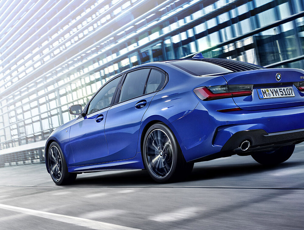 Blue BMW 3 Series side and rear view