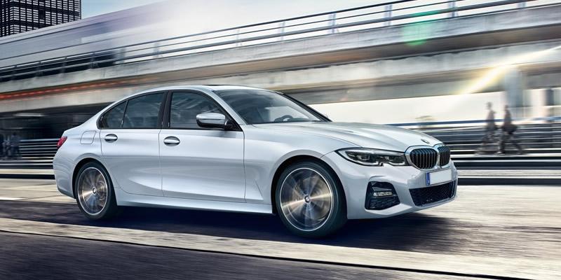 White BMW 3 Series Side view