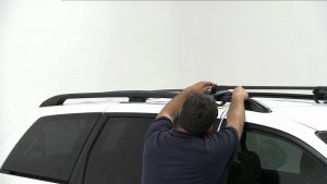 drive more efficiently, man removing roof rack