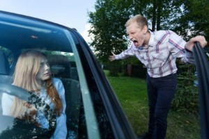 Image of neighbour arguing with a driver of a car